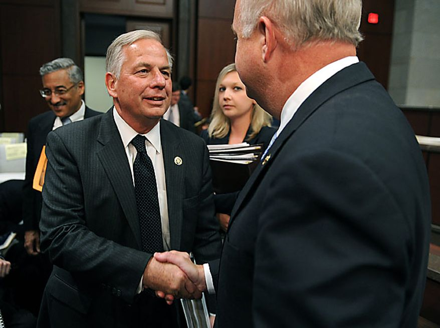 Rep. Gene Green (D-TX) shakes hands with Rep. Jo Bonner (R-AL) after the two testified before a House Ethics Subcommittee hearing on the alleged ethics violations conducted by Rep. Charlie Rangel, in Washington on July 29, 2010.  Bonner and Green announced Rangel's charges which include allegations including failure to pay taxes, misuse of rental property and soliciting funds for a center at City College of New York.  UPI/Kevin Dietsch