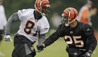 Cincinnati Bengals wide receiver Antonio Bryant (81) runs a pattern against cornerback Morgan Trent (25) during the NFL football team's first practice, Thursday, July 29, 2010, in Georgetown, Kentucky. (AP Photo/Al Behrman)