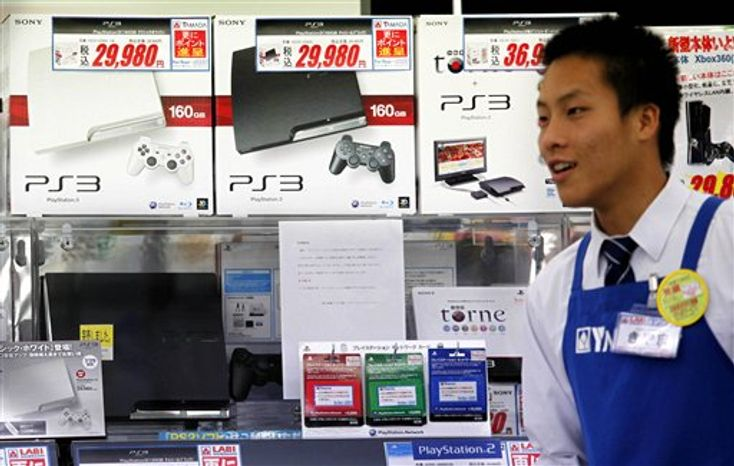 A man looks at new PlayStation 3 on display at Yamada Denki LABI electric shop in Tokyo, Thursday, July 29, 2010. Sony bounced back to profit last quarter and raised its full-year earnings forecast, fueled by stronger demand for its PlayStation 3 gaming consoles, personal computers and televisions.(AP Photo/Shuji Kajiyama)