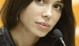 FILE - In this April 19, 2010 file photo, Mel Gibson's ex-girlfriend, Russian-born singer, songwriter Oksana Grigorieva, talks during a news conference in Moscow. Grigorieva says she feared for her life and thought Gibson might kill her during a fight in January, 2010. (AP Photo/Mikhail Metzel, File)