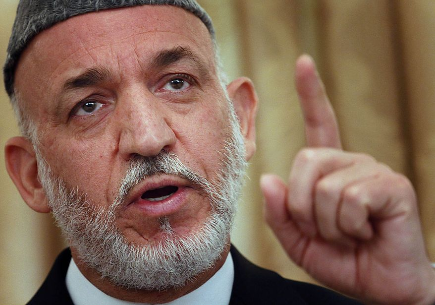 Afghan President Hamid Karzai speaks during a press conference at the presidential palace in Kabul, Afghanistan on Thursday, July 29, 2010. Mr. Karzai says the release of secret documents have endangered the lives of Afghan citizens who have cooperated with the international forces. (AP Photo/Musadeq Sadeq)