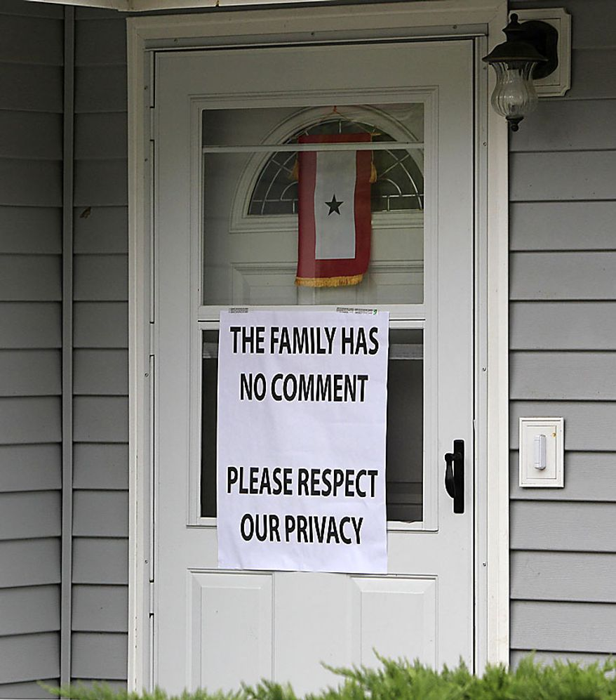 A sign asking for privacy is posted on the front door of the home of Petty Officer 3rd Class Jarod Newlove, Thursday, July 29, 2010, in Seattle. According to a senior U.S. military official and Afghan officials, Newlove, the second U.S. Navy sailor who went missing in a dangerous part of eastern Afghanistan was found dead and his body recovered. The family of Newlove, 25, had been notified of his death, the U.S. military official said on the condition of anonymity, because he was not authorized to disclose the information. (AP Photo/Elaine Thompson)