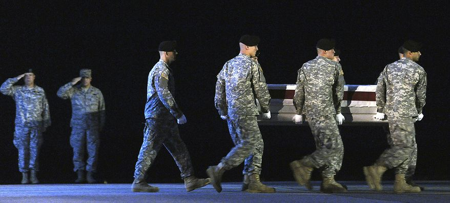 In this  July 26, 2010, file photo, An Army carry team carries a transfer case containing the remains of Spc. Joseph A. Bauer at Dover Air Force Base, Del. According to the Department of Defense, Bauer, of Cincinnati, died while supporting Operation Enduring Freedom in Afghanistan. NATO announced Friday, July 30, 2010, that six more U.S. troops have died in Afghanistan, bringing the death toll for July to at least 66 and surpassing the previous month's record as the deadliest for American forces in the nearly 9-year-old war. (AP Photo/Steve Ruark, File)