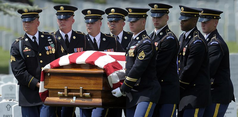 The casket of Army Pfc. David T. Miller is carried during his funeral service at Arlington National Cemetery in Arlington, Va., Wednesday, July 28, 2010. Miller was killed in Afghanistan. Miller of Wilton, N