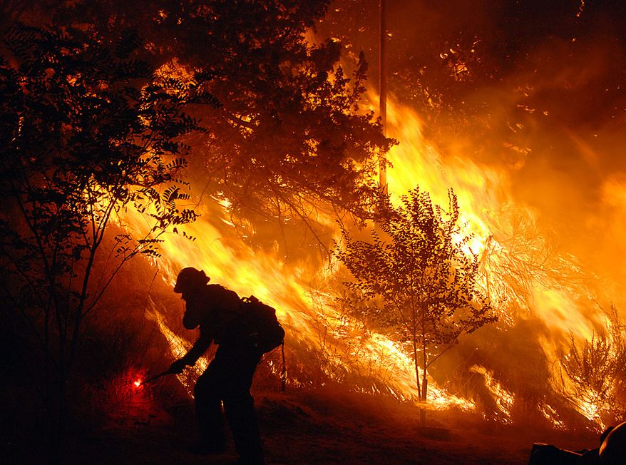 A U.S. Forest Service firefighter sets an intentional backfire to keep flames away from homes in Leona Valley, just west of Palmdale, Calif., and along Lake Elizabeth Road. Brush fire swept over more than 7 square miles, prompted evacuations and burned structures in rural Los Angeles County Thursday as water-dropping helicopters and crews scrambled to get ahead of the blaze. About 1,200 homes in the community of Leona Valley were under mandatory evacuation orders on Thursday evening, Los Angeles County Fire Inspector Matt Levesque said. Firefighters have no idea as to when the fire can be controlled. (AP Photo/Mike Meadows)