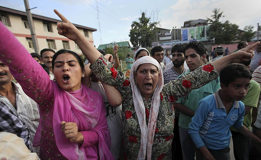 Kashmiri women shout freedom slogans as they accompany others carrying the bodies of two civilians outside a local hospital in Srinagar, India, Friday, July 30, 2010. Paramilitary soldiers fired on hundreds of demonstrators in Indian Kashmir on Friday, killing two men and wounding at least 12 others, police said as protests against Indian rule spread across the region. (AP Photo/Dar Yasin)