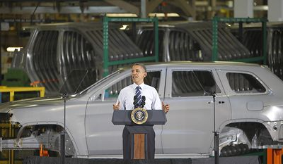 President Barack Obama addresses employees at the Chrysler's Jefferson North Assembly Plant in Detroit, Friday, July 30, 2010. (AP Photo/Carlos Osorio)