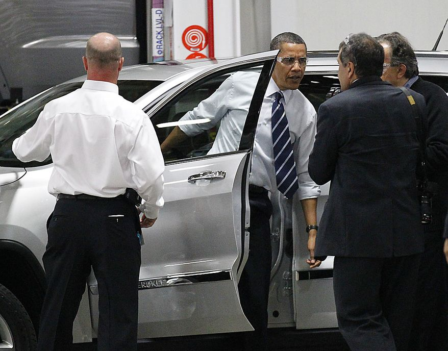 President Barack Obama steps out of a Jeep Grand Cherokee during his tour of the Jefferson North Chrysler Plant in Detroit, Friday, July 30, 2010. The is plant is where the Cherokee is assembled. (AP Photo/Pablo Martinez Monsivais)