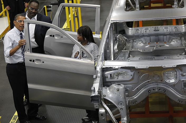 President Barack Obama examines the car door during his tour of the Jefferson North Chrysler Plant in Detroit, Friday, July 30, 2010, where the Jeep Grand Cherokee is assembled. (AP Photo/Pablo Martinez Monsivais)