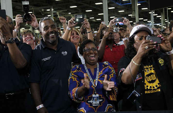 Autoworkers react to the arrival of President Barack Obama during his visit to the Jefferson North Chrysler Plant in Detroit, Friday, July 30, 2010, where the Jeep Grand Cherokee is assembled. (AP Photo/Pablo Martinez Monsivais)