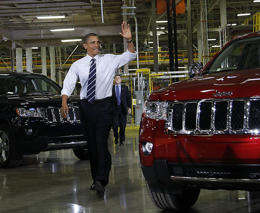 President Barack Obama waves as he is introduced before delivering remarks during his visit to the Jefferson North Chrysler Plant in Detroit, Friday, July 30, 2010, where the Jeep Grand Cherokee is assembled. (AP Photo/Pablo Martinez Monsivais)