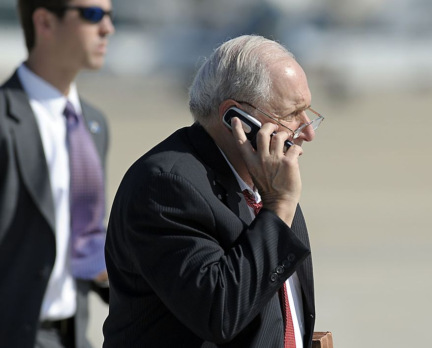 Sen. Carl Levin, D-Mich, talks on a cell phone as walks towards Air Force One at Andrews Air Force Base, Md., Friday, July 30, 2010, prior to boarding ahead of President Barack Obama, for a flight to Michigan. (AP Photo/Cliff Owen)