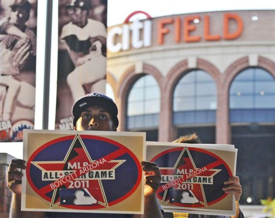 Protestors gather outside of CitiField before the Arizona Diamondbacks play the New York Mets in opposition to Arizona's immigration law on Friday, July 30, 2010 in the Queens borough of New York. Arizona Gov. Jan Brewer said Friday she is asking legislators to consider whether they should change the state's immigration law in the wake of a judge's ruling blocking enforcement of key parts of it. Even though the law's critics scored a huge victory with the decision, passions among hundreds of immigrant rights supporters continue to flare. (AP Photo/Swoan Parker)