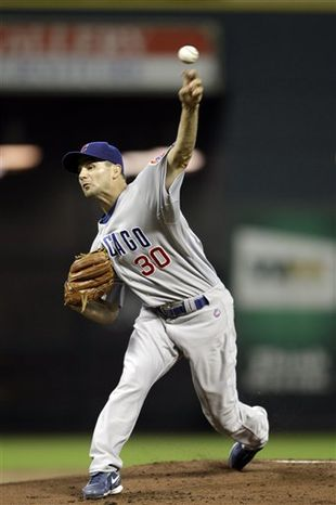 FILE - In this July 27, 2010, file photo, Chicago Cubs pitcher Ted Lilly delivers a pitch against the Houston Astros during the first inning of a baseball game in Houston. Lilly was traded to the Los Angeles Dodgers along with infielder Ryan Theriot on Saturday, July 31, 2010, for infielder Blake DeWitt and minor league right-handers Kyle Smit and Brett Wallach.  (AP Photo/David J. Phillip, File)