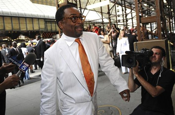 """FILE-This July 10, 2010 file photo shows director Spike Lee entering Cipriani's for the wedding of Carmelo Anthony and LaLa Vasquez, in New York.  Lee has screened his new four-hour documentary on the massive BP oil spill in the Gulf of Mexico and says no one from the oil giant is speaking to him. The director showed """"If God Is Willing and Da Creek Don't Rise"""" at the National Association of Black Journalists convention in San Diego on Saturday July 31, 2010. It airs in August on HBO. (AP Photo/ Louis Lanzano,File)"""