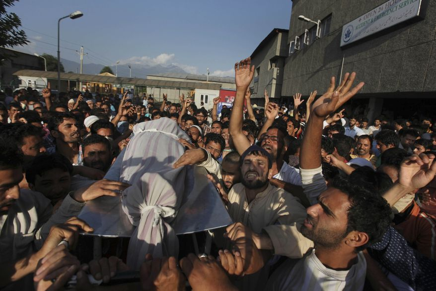 Kashmiris shout pro-freedom slogans as relatives and friends carry the body of Afroza Wani on a stretcher outside a hospital in Srinagar, India, on Sunday, Aug. 1, 2010. Four people were killed Sunday by security forces who opened fire on thousands of protesters at two separate places in increasingly violent Indian Kashmir, bringing the death toll from weeks of clashes to 27. (AP Photo/Dar Yasin)