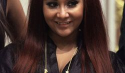 """** FILE ** Nicole """"Snooki"""" Polizzi, a cast member of MTV's """"Jersey Shore"""" reality series, is shown at the New York Stock Exchange on July 27, 2010.  (AP Photo/Richard Drew, File)"""