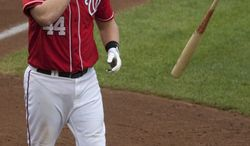 ASSOCIATED PRESS Washington Nationals' Adam Dunn tosses his bat after striking out during the 10th inning of a baseball game against the Philadelphia Phillies, Sunday, Aug. 1, 2010, in Washington. The Phillies beat the Nationals 6-4 in 11 innings.