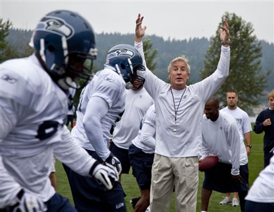 Seattle Seahawks quarterback Matt Hasselbeck (8) leads teammates in a drill during an NFL football practice Friday, Aug. 6, 2010, in Renton, Wash. (AP Photo/Elaine Thompson)