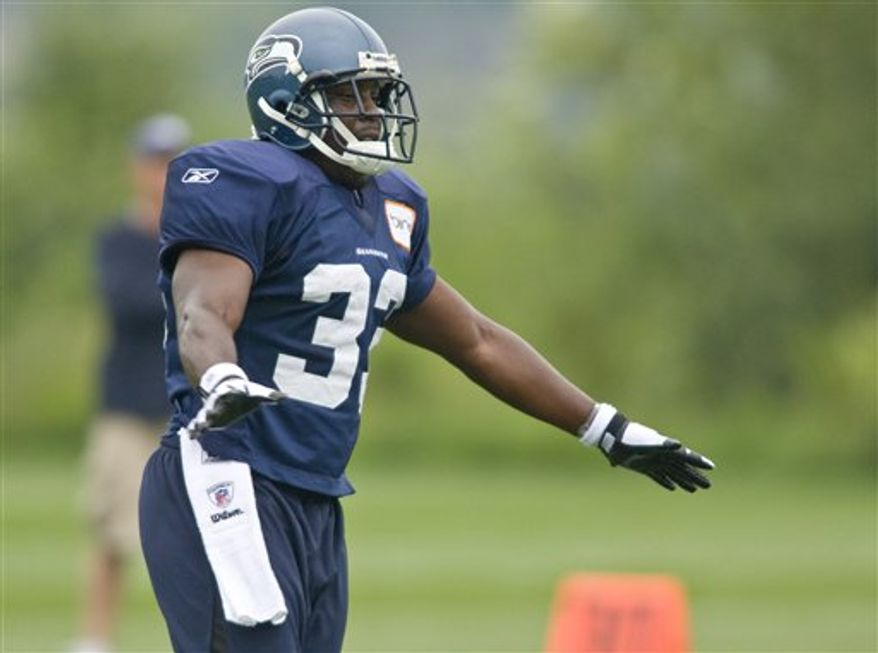 Seattle Seahawks' Leon Washington looks on during the opening day of NFL football training camp on Saturday, July 31, 2010, in Renton, Wash. Washington reached his goal of being on the field for the first day of training camp after suffering a compound fracture of his right leg nine months ago. (AP Photo/John Froschauer)