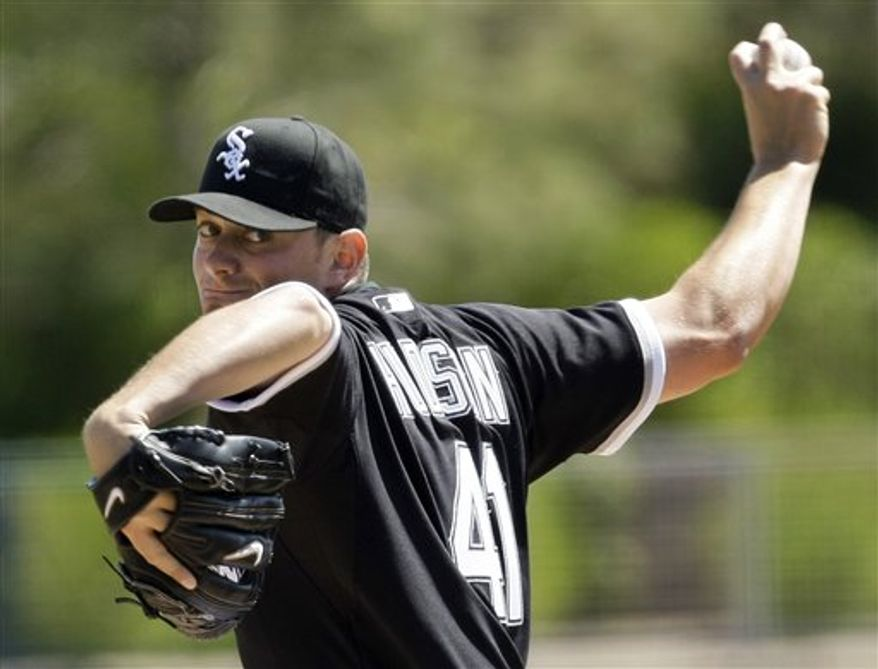 FILE - This March 28, 2010, file photo shows Chicago White Sox starter Daniel Hudson pitching in the first inning in a spring training baseball game against the Kansas City Royals, in Glendale, Ariz.  The Arizona Diamondbacks have traded right-hander Edwin Jackson to the Chicago White Sox for pitchers Dan Hudson and David Holmberg. (AP Photo/Tony Dejak, FIle)