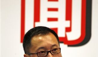 "In this June 8, 2009, fine photo, Jianhua ""Kenny"" Huang attends a press conference held in Beijing.  Chinese businessman Huang has offered to buy Liverpool's 237 million pound debt ($374 million) from a British bank in an attempt to end Tom Hicks and George Gillett Jr.'s control of the English Premier League club.  (AP Photo/Ng Han Guan, File)"