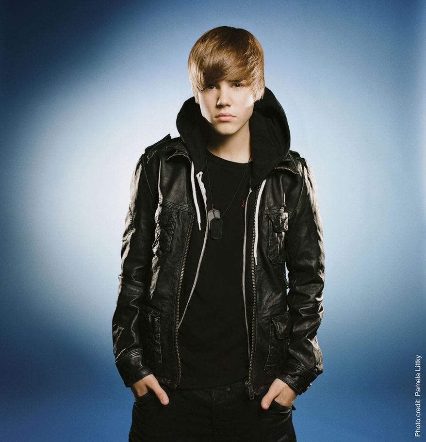 Justin Bieber, 16, poses in a HarperCollins publicity shot. The 16-year-old has a book deal to write his memoirs.  (PRNewsFoto/HarperCollins, Pamela Littky)