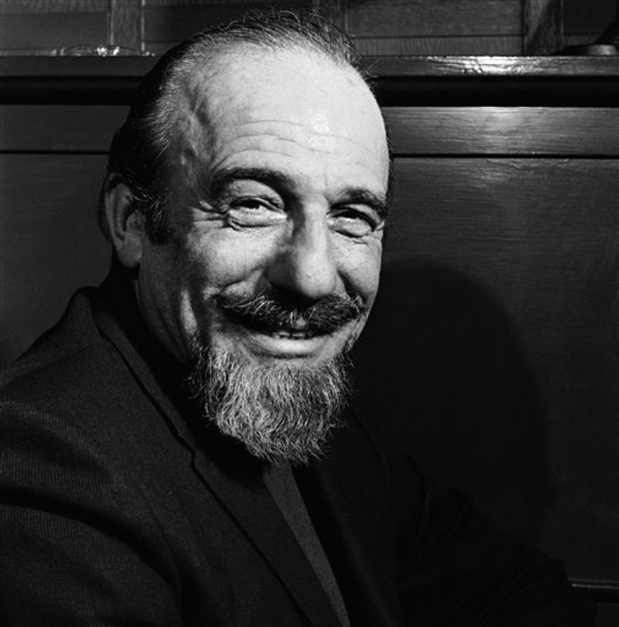 "FILE - In this file photo of Jan. 5, 1968, conductor Mitch Miller is seen at the Billy Rose Theater in New York. Miller, the goateed orchestra leader who asked Americans to ""Sing Along With Mitch"" on television and records, has died at age 99. His daughter said Miller died in New York City after a short illness. (AP Photo/Bob Wands, File)"