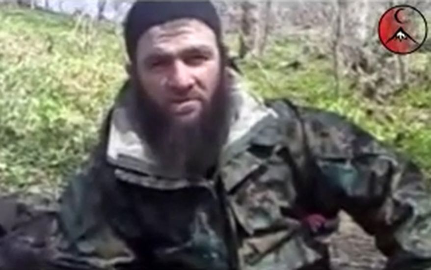 This undated frame grab image taken from files made available by IntelCenter and taken from a video posted on a pro-rebel Web site Wednesday March 31, 2010, purports to show Chechen militant leader Doku Umarov. The leader of Chechnya's separatist militants, who claimed responsbility for the Moscow subway bombings that killed 40 people in March, has announced in a purported video posted on YouTube on Sunday, Aug. 1, 2010, that he is stepping down. (AP Photo/IntelCenter, File)