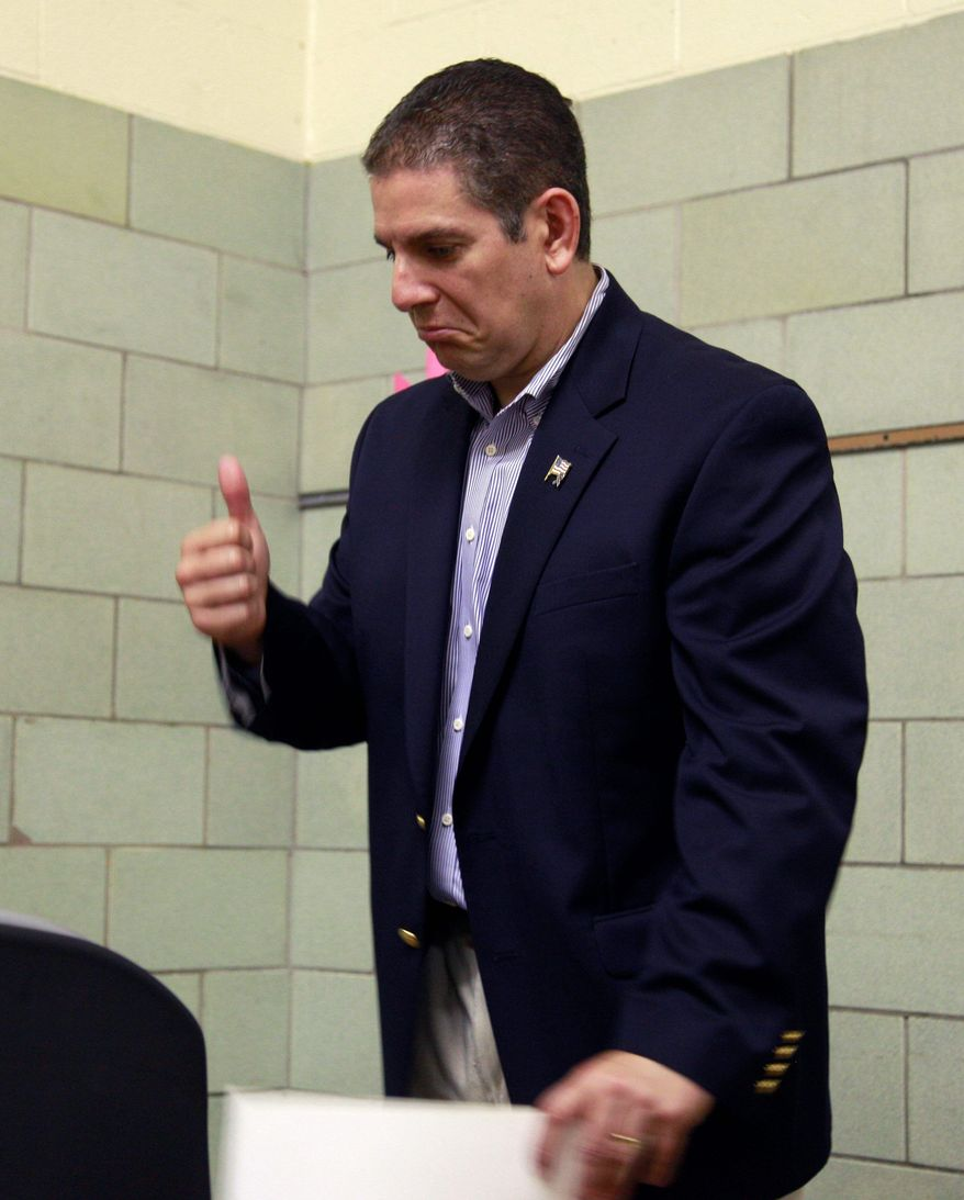 Democratic gubernatorial candidate Virg Bernero gives a thumbs up after voting in the party primary Tuesday in Lansing, Mich. (AP Photo)