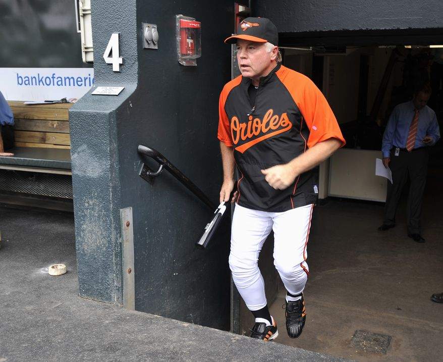 ASSOCIATED PRESS The Baltimore Orioles' new manager, Buck Showalter, takes the field for batting practice before the Orioles played the Los Angeles Angels in a baseball game, Showalter's first managing the team, Tuesday, Aug. 3, 2010, in Baltimore.
