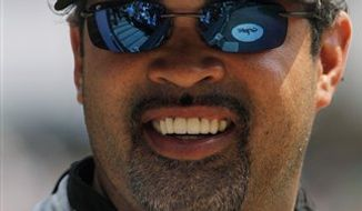 Chicago White Sox manager Ozzie Guillen talks with a player before a baseball game against the Oakland Athletics on Sunday, Aug. 1,  2010, in Chicago. The White Sox won 4-1. (AP Photo/John Smierciak)