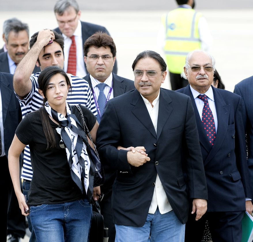 Pakistan President Asif Ali Zardari, 2nd right, is accompanied by his son Bilawal, striped shirt, and daughter, Asifa, left, when they arrived at London's Heathrow Airport , Tuesday, Aug. 3, 2010. (AP Photo)