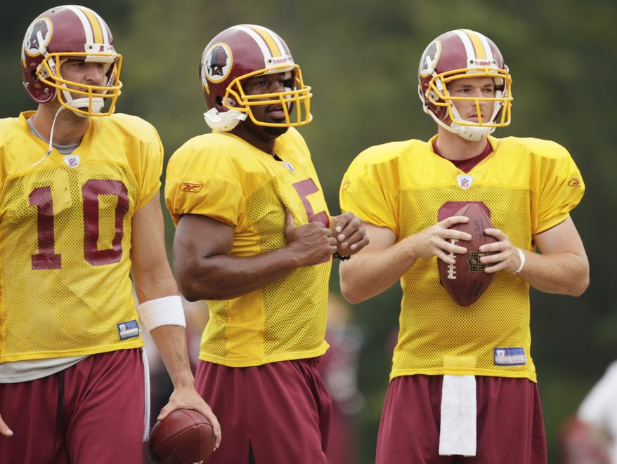 ASSOCIATED PRESS Washington Redskins quarterbacks from left Richard Bartel, Donovan McNabb and John Beck, gather at the NFL football team's training camp at Redskins Park, Tuesday, Aug. 3, 2010, in Ashburn, Va.
