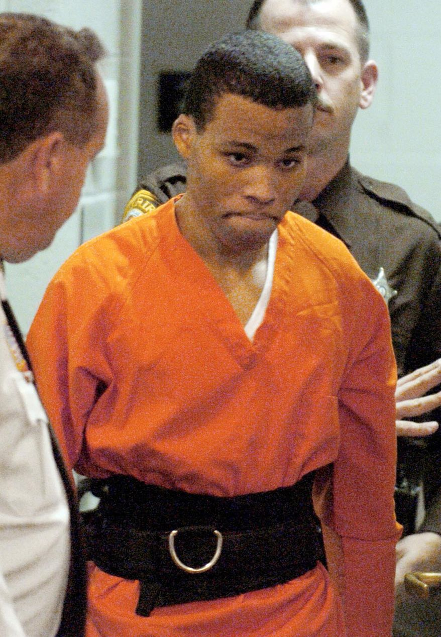 "In a Tuesday, October 26, 2004, photo, convicted sniper Lee Boyd Malvo enters a courtroom in the Spotsylvania Circuit Court in Spotsylvania, Va. Malvo, convicted in the deadly sniper attacks that terrorized the Washington, D.C., area in 2002, says two others planned to participate in the attacks but backed out. The revelation comes in a prison interview for the Thursday premier of ""Confessions of the DC Sniper with William Shatner: An Aftermath Special"" on the A&E television network. (AP Photo/Mike Morones, File)"