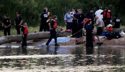 Members of the Shreveport Fire Department and deputies from the Caddo Parish Sheriff's Office work the scene at Charles and Marie Hamel Memorial Park in Shreveport, La., on Monday, Aug. 2, 2010, in search of teens who drowned while swimming in the Red River late Monday afternoon. (AP Photo/Shreveport Times, Henrietta Wildsmith)