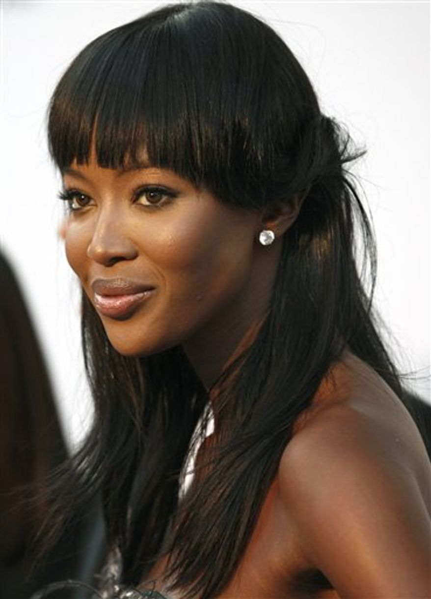 FILE - In this May 20, 2010 file photo, British model Naomi Campbell arrives for the amfAR Cinema Against AIDS benefit, during the 63rd Cannes international film festival, in Cap d'Antibes, France. Judges at the Special Court for Sierra Leone have rejected  Wednesday Aug. 4, 2010 a final protest from Charles Taylor, clearing the way for model Naomi Campbell to testify at his war crimes trial. Taylor's lawyer had objected to Campbell testifying, arguing that the prosecution had not provided a summary of her likely testimony.(AP Photo/Matt Sayles, File)