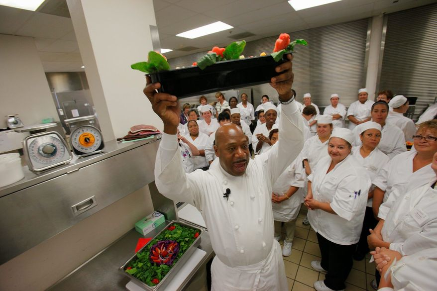 Chef Daniel Young chooses the winning fruit salad tray made by Denver public schools food-service personnel during a half day of instruction on how to use fresh foods to make healthier options for students. (Associated Press)