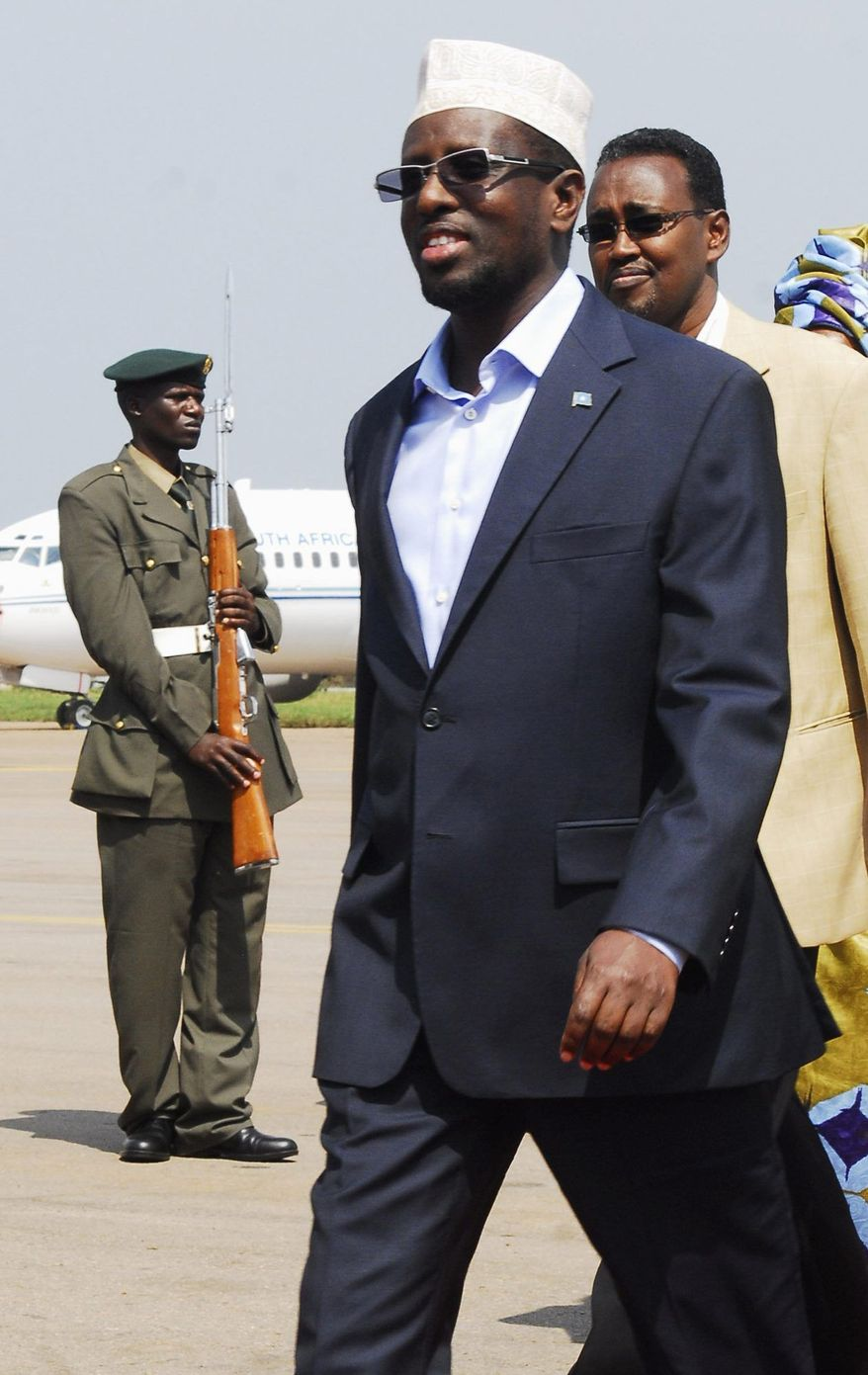Somali President Sheik Sharif Sheik Ahmed arrives in Entebbe, Uganda, for the 15th African Union summit. African leaders and U.S. officials called for stepped-up efforts in Somalia at the summit in Kampala, Uganda. (Associated Press)