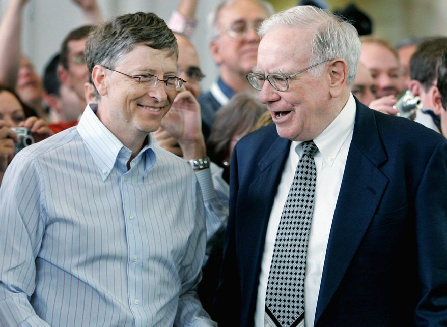 BIG BUCKS: Microsoft mogul Bill Gates (left) and investor Warren Buffett have encouraged fellow billionaires to pledge 50 percent of their fortunes to charity. (Associated Press)