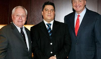 In this image dated November 10, 2009, issued by GameDay, showing owners of Liverpool soccer club George Gillett, left, and Tom Hicks, right, with Middle East financial representative Yahya Kirdi, during an NHL game in Montreal, Canada.  Yahya Kirdi said in a statement on Wednesday Aug. 4, 2010, that a Canadian-based consortium led by a Syrian businessman is close to buying England's Liverpool soccer club from the club's American owners, with negotiations at an advanced stage. (AP Photo / Denis Brodeur)