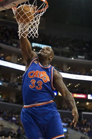 FILE - In this Jan. 16, 2010, file photo, Cleveland Cavaliers' Shaquille O'Neal dunks the ball against the Los Angeles Clippers during an NBA basketball game in Los Angeles. The Boston Celtics have signed O'Neal. The team announced Wednesday, Aug. 4, 2010, that it had signed the 15-time NBA All-Star, who had been a free agent after spending last season with the Cavaliers. (AP Photo/Jeff Lewis, File)
