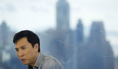 """In this photo taken Sunday, Aug. 1, 2010, Hong Kong actor Donnie Yen reacts during an interview with The Associated Press in Hong Kong. For years, the 47-year-old actor worked in the shadow of Jackie Chan and Jet Li. But with the box office success of his back-to-back biopics about Bruce Lee's kung fu master, """"Ip Man,"""" Yen has become a major action star in his own right. (AP Photo/Vincent Yu)"""