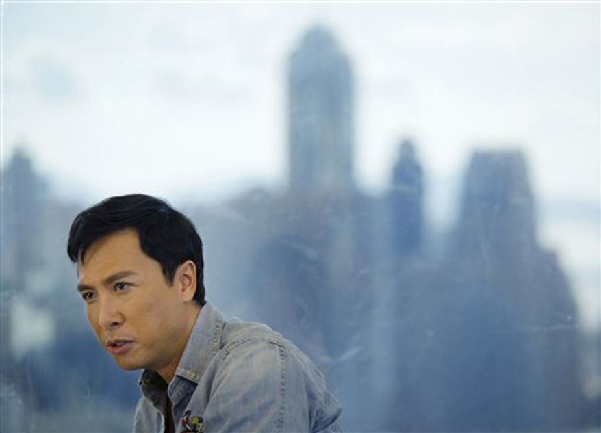 "In this photo taken Sunday, Aug. 1, 2010, Hong Kong actor Donnie Yen reacts during an interview with The Associated Press in Hong Kong. For years, the 47-year-old actor worked in the shadow of Jackie Chan and Jet Li. But with the box office success of his back-to-back biopics about Bruce Lee's kung fu master, ""Ip Man,"" Yen has become a major action star in his own right. (AP Photo/Vincent Yu)"