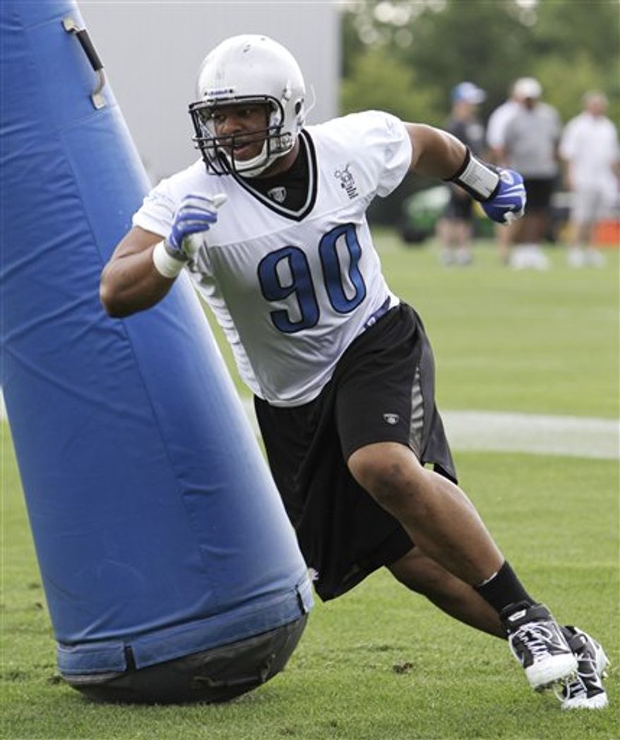 FILE-In this June 23, 2010 file  photo, Detroit Lions defensive tackle Ndamukong Suh practices during NFL football minicamp in Allen Park, Mich.  Suh has missed his third straight day of practice with the Detroit Lions. Coach Jim Schwartz says it's disappointing Suh has missed some opportunities in training camp that are gone forever. (AP Photo/Paul Sancya,File)