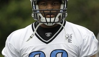 Detroit Lions defensive tackles Ndamukong Suh, right, and Joe Cohen work out during NFL football training  camp in Allen Park, Mich., Wednesday, Aug. 4, 2010. (AP Photo/Carlos Osorio)