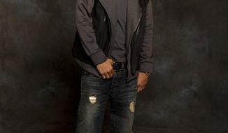 "In this July 15, 2010 photo, recording artist Trey Songz poses for a portrait at the InterContinental Hotel, Buckhead, in Atlanta. Songz's star rose over this past year, churning out the R&B chart-topping smash ""I Invented Sex"" along with a slew of other hits that cracked Billboard's R&B top 10. Songz is gearing up to release his new album ""Passion, Pain and Pleasure"" on Sept. 14. But until his release, he'll introduce some of the new album's songs during his upcoming concert tour, which kicks off Friday, Aug. 6, 2010. (AP Photo/Paul Abell)"