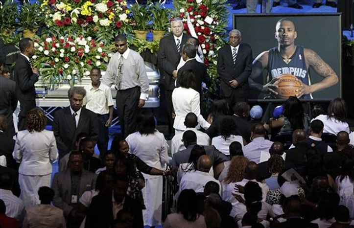 Family and friends of slain NBA basketball player Lorenzen Wright grieve at the casket of Wright during a memorial service at the FedExForum in Memphis, Tenn., Wednesday, Aug. 4, 2010.  Wright's body was found July 28 in woods outside Memphis after he had been missing for 10 days. He was shot to death in what police are calling a homicide. (AP Photo/Lance Mu