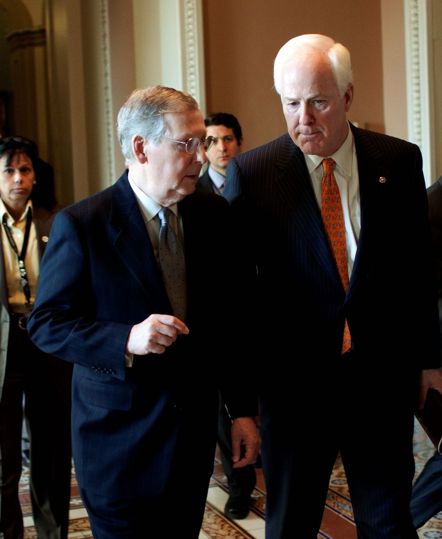 Senate Minority Leader Mitch McConnell of Ky., left, talks with Sen. John Cornyn, D-Texas, on Capitol Hill in Washington, Tuesday, March 9, 2010, as they walk to McConnell's office, following the weekly caucus luncheons. (AP Photo/Harry Hamburg)
