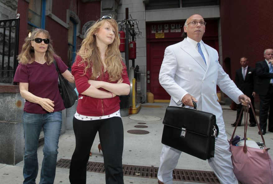 Caroline Giuliani (center), 20, and her mother, Donna Hanover, leave the 19th Precinct police station in New York on Wednesday, Aug. 4, 2010. A law enforcement official said Miss Giuliani, Rudy Giuliani's daughter, was arrested after she was seen on video pocketing makeup at a cosmetic store. (AP Photo/Frank Franklin II)